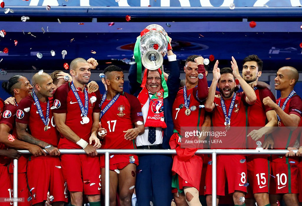 Fernando Santos manager of Portugal (c) lifts the Henri Delaunay trophy after his side win 1-0 against France during the UEFA EURO 2016 Final match between Portugal and France at Stade de France on July 10, 2016 in Paris, France.