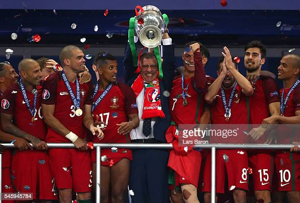 Fernando Santos manager of Portugal lifts the Henri Delaunay trophy after his side win 10 against France during the UEFA EURO 2016 Final match...