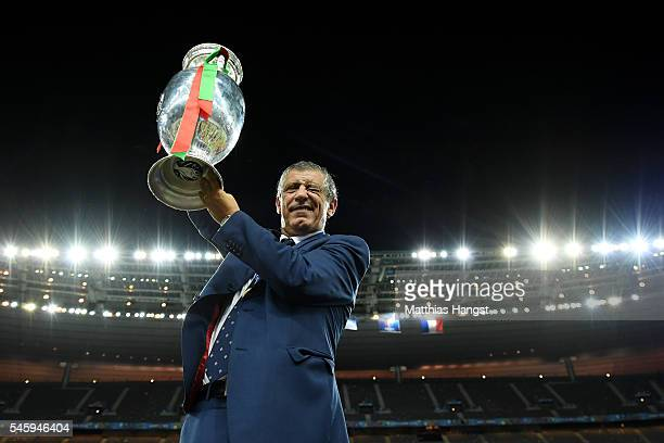 Fernando Santos manager of Portugal lifts the Henri Delaunay trophy to celebrate after his team's 10 win against France in the UEFA EURO 2016 Final...