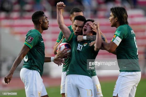 Fernando Saucedo of Bolivia celebrates with teammates after scoring the first goal of his team during a match between Bolivia and Colombia as part of...