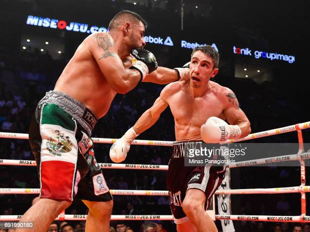 Fernando Silva connects with a left punch against Mikael Zewski during the Super Welterweight match at the Bell Centre on June 3 2017 in Montreal...