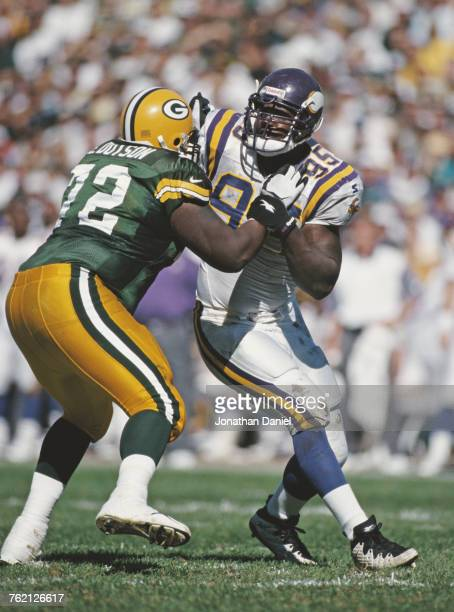 Fernando Smith, Defensive End for the Minnesota Vikings in contact with Earl Dotson, Offensive Tackle for the Minnesota Vikings during their National...