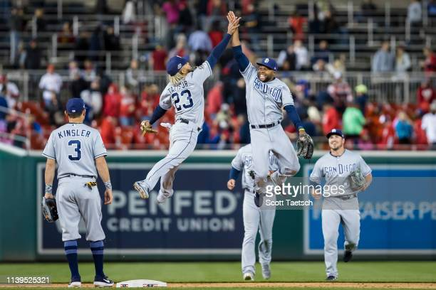 Fernando Tatis Jr #23 and Manuel Margot of the San Diego Padres celebrate after beating the against the Washington Nationals at Nationals Park on...