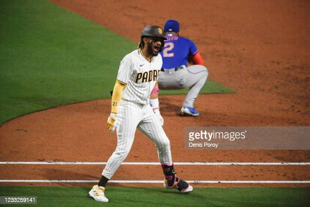 Fernando Tatis Jr. #23 celebrates after hitting a two-rrun home run during the third inning of a baseball game against the New York Mets at Petco...