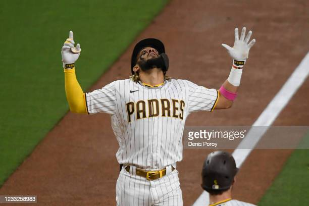 Fernando Tatis Jr. #23 looks skyward after hitting a two rrun home run during the third inning of a baseball game against the New York Mets at Petco...