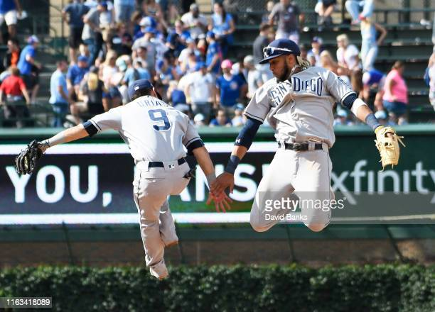 Fernando Tatis Jr #23 of the San Diego Padres and Luis Urias celebrate their 51 win against the Chicago Cubs at Wrigley Field on July 21 2019 in...