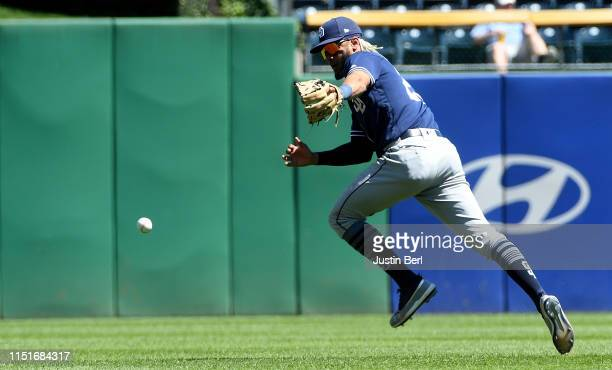 Fernando Tatis Jr #23 of the San Diego Padres cannot make a play on a ball off the bat of Jason Martin of the Pittsburgh Pirates in the fifth inning...
