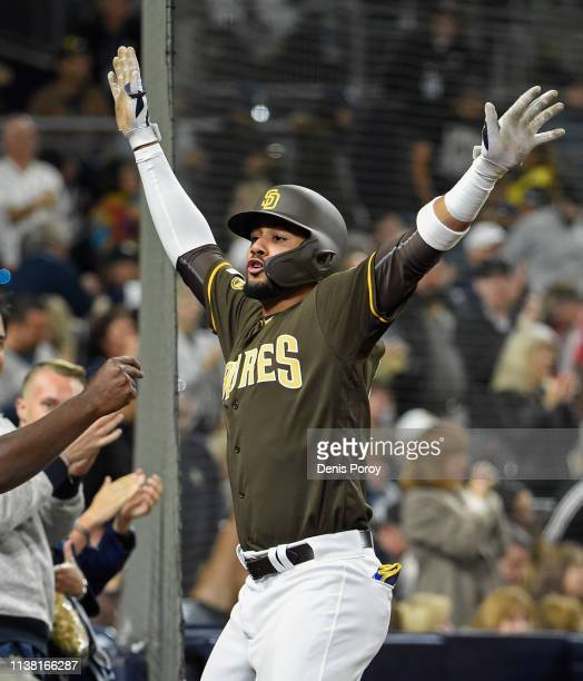 Fernando Tatis Jr #23 of the San Diego Padres celebrates after hitting a solo home run during the third inning of a baseball game against the...