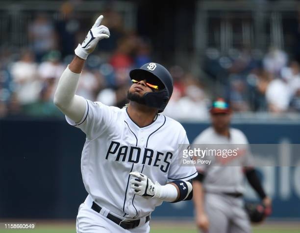 Fernando Tatis Jr #23 of the San Diego Padres celebrates after hitting a solo home run during the first inning of a baseball game against the...