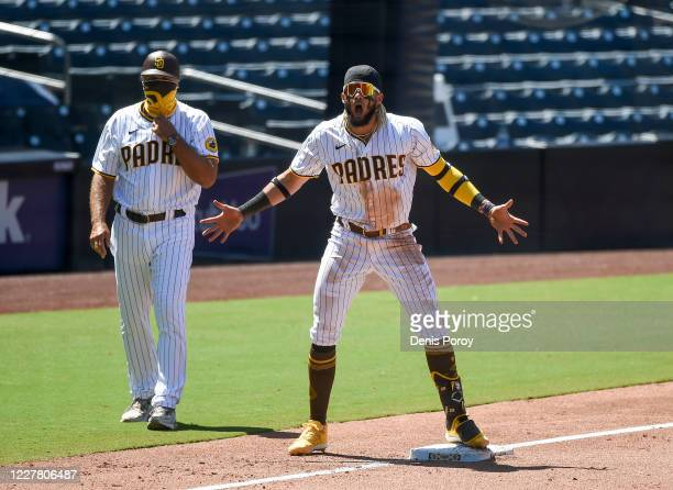 Fernando Tatis Jr. #23 of the San Diego Padres celebrates after hitting a three RBI triple during the fourth inning of a baseball game against the...