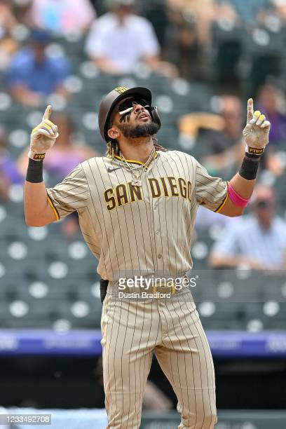 Fernando Tatis Jr. #23 of the San Diego Padres celebrates after hitting a third inning solo homerun against the Colorado Rockies at Coors Field on...