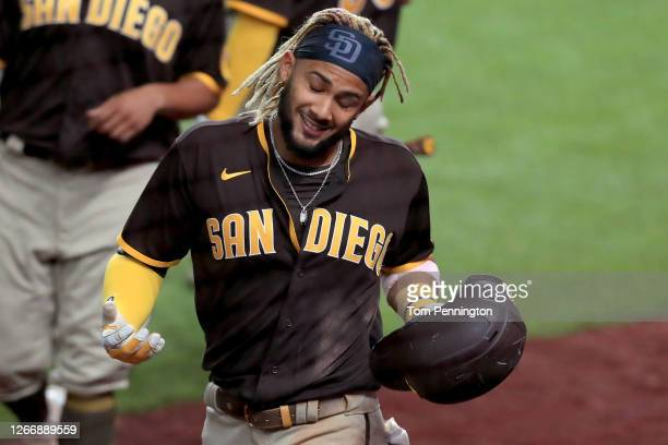 Fernando Tatis Jr. #23 of the San Diego Padres celebrates after hitting a grand slam against the Texas Rangers in the top of the eighth inning at...