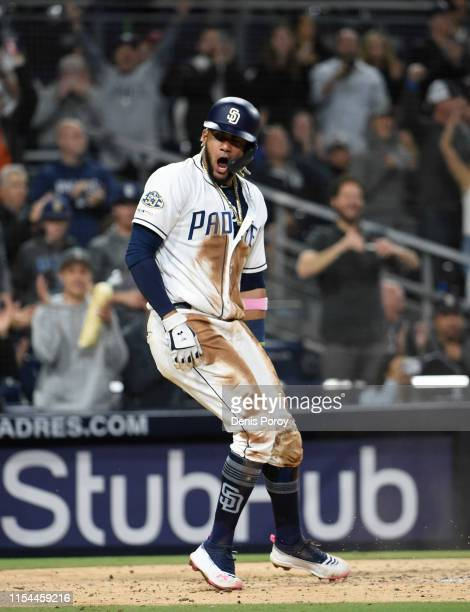 Fernando Tatis Jr #23 of the San Diego Padres celebrates after scoring during a baseball game against the Washington Nationals at Petco Park June 6...