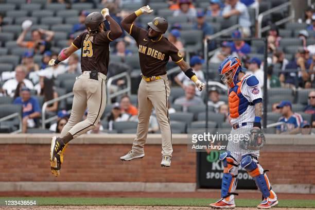 Fernando Tatis Jr. #23 of the San Diego Padres celebrates hitting a grand slam with Jurickson Profar of the San Diego Padres in front of Tomas Nido...