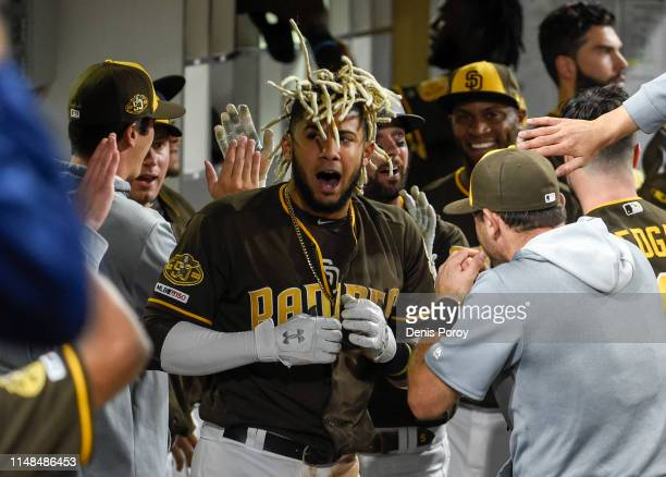 Fernando Tatis Jr #23 of the San Diego Padres celebrates in the dugout after hitting a tworun home run during the sixth inning of a baseball game...