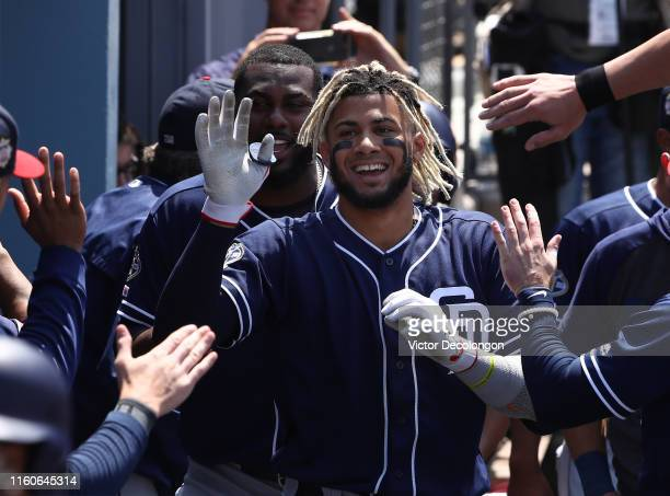 Fernando Tatis Jr #23 of the San Diego Padres celebrates in the dugout with teammates after hitting a threerun home run during the fifth inning of a...