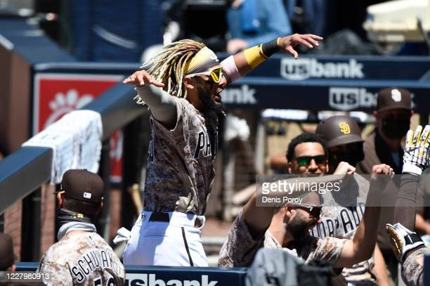 Fernando Tatis Jr. #23 of the San Diego Padres celebrates in the dugout after Manny Machado hit a solo home run during the first inning of a baseball...