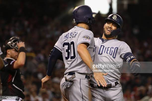 Fernando Tatis Jr #23 of the San Diego Padres celebrates with Eric Hosmer after hitting a tworun home run against the Arizona Diamondbacks during the...