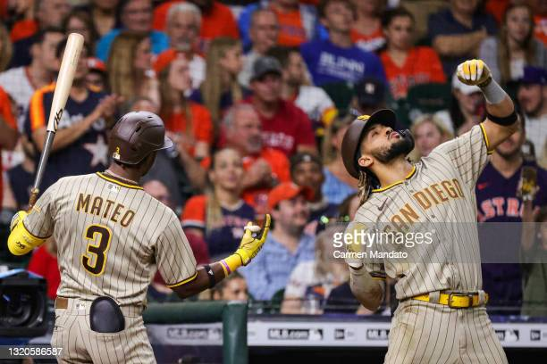 Fernando Tatis Jr. #23 of the San Diego Padres celebrates with Jorge Mateo after hitting a home run to left field during the eighth inning against...