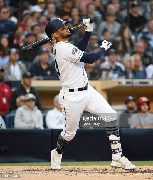 Fernando Tatis Jr #23 of the San Diego Padres flies out during the fourth inning of a baseball game against the Cincinnati Reds at Petco Park April...