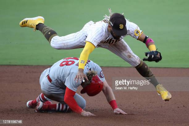 Fernando Tatis Jr. #23 of the San Diego Padres forces out Harrison Bader of the St. Louis Cardinals at second base during the third inning of Game...