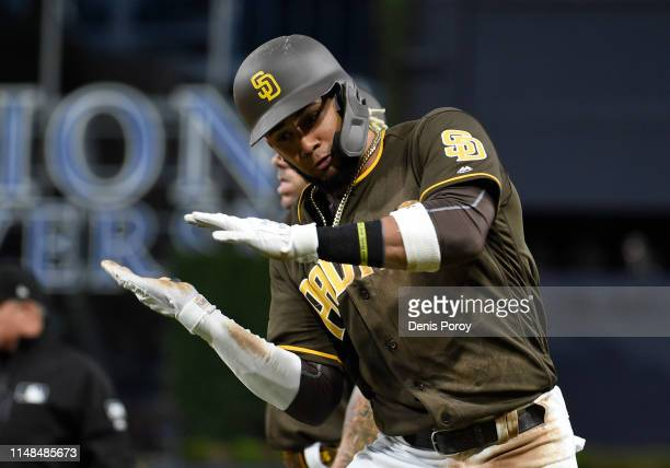 Fernando Tatis Jr #23 of the San Diego Padres gestures after hitting a single during the third inning of a baseball game against the Washington...