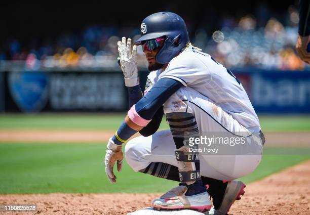 Fernando Tatis Jr #23 of the San Diego Padres gestures back to the dugout after hitting a single during the second inning of a baseball game against...