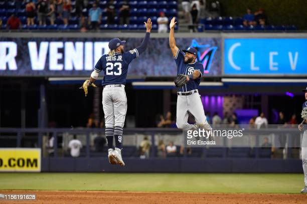 Fernando Tatis Jr #23 of the San Diego Padres high fives Manuel Margot after defeating the Miami Marlins at Marlins Park on July 17 2019 in Miami...
