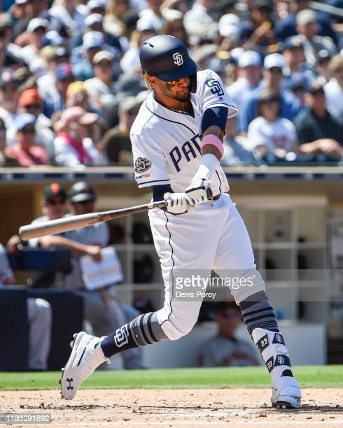 Fernando Tatis Jr #23 of the San Diego Padres hits a single during the second inning on Opening Day against the San Francisco Giants at Petco Park...