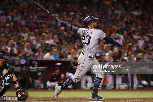 Fernando Tatis Jr #23 of the San Diego Padres hits a tworun home run against the Arizona Diamondbacks during the third inning of the MLB game at...