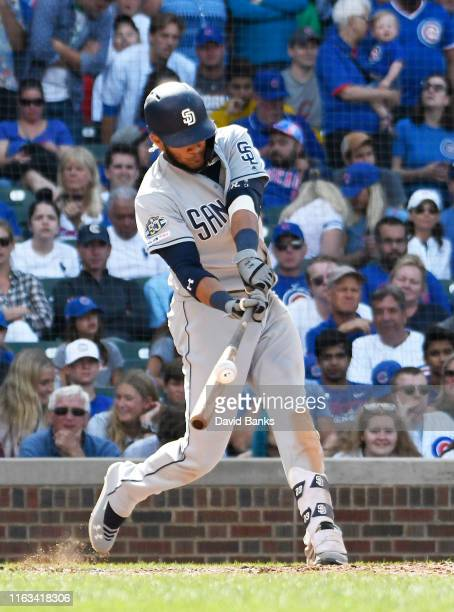 Fernando Tatis Jr #23 of the San Diego Padres hits a tworun single against the Chicago Cubs during the ninth inning at Wrigley Field on July 21 2019...