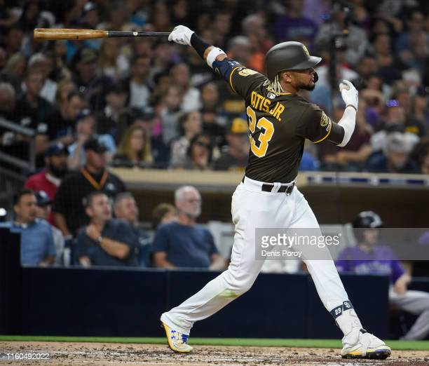Fernando Tatis Jr #23 of the San Diego Padres hits an RBI double during the third inning of a baseball game against the Colorado Rockies at Petco...