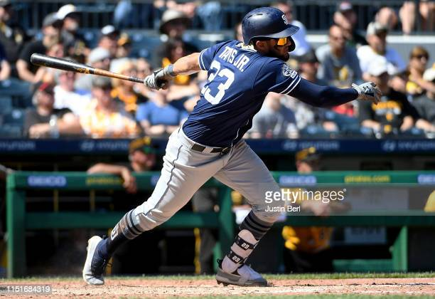 Fernando Tatis Jr #23 of the San Diego Padres hits an RBI single to center field in the sixth inning during the game against the Pittsburgh Pirates...