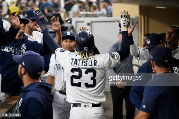 Fernando Tatis Jr #23 of the San Diego Padres is congratulated after scoring during the first inning of a baseball game against the Tampa Bay Rays at...