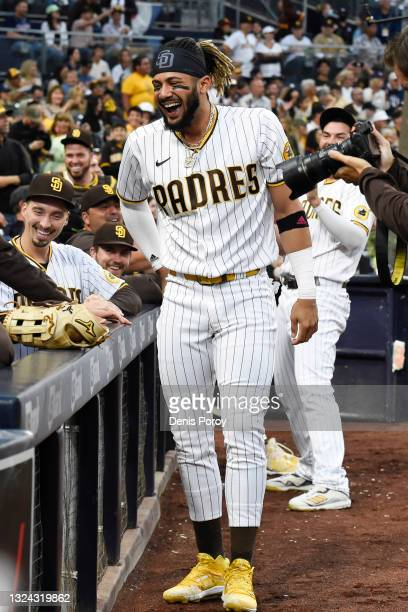 Fernando Tatis Jr. #23 of the San Diego Padres jokes around during the second inning of a baseball game against the Cincinnati Reds at Petco Park on...