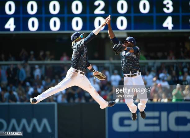 Fernando Tatis Jr #23 of the San Diego Padres left and Manuel Margot of the San Diego Padres celebrate after beating the Cincinnati Reds 43 in a...
