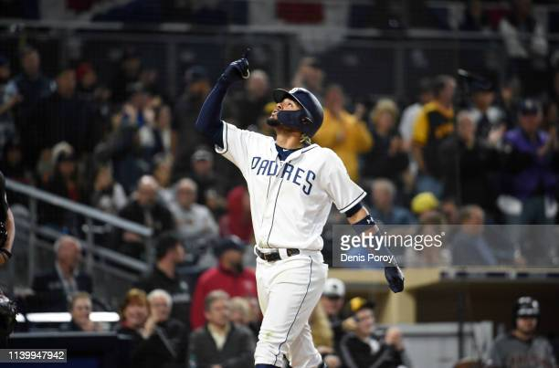 Fernando Tatis Jr #23 of the San Diego Padres points skyward after hitting a tworun home run during the sixth inning of a baseball game against the...
