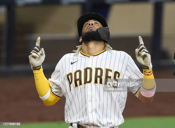 Fernando Tatis Jr #23 of the San Diego Padres points skyward after hitting a solo home run during the fifth inning against the Los Angeles Dodgers at...
