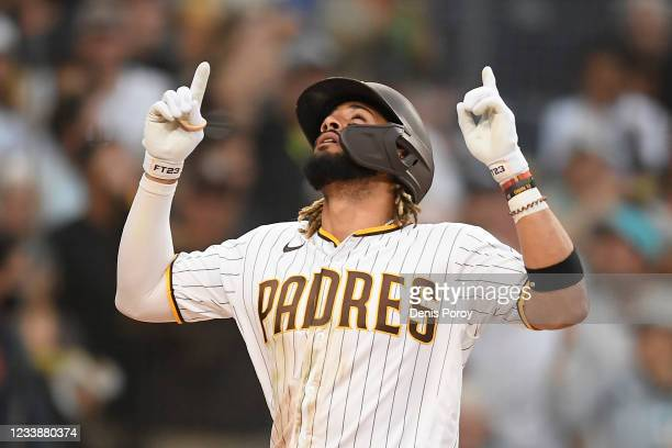 Fernando Tatis Jr. #23 of the San Diego Padres points skyward after hitting a solo home run during the fourth inning of a baseball game against...