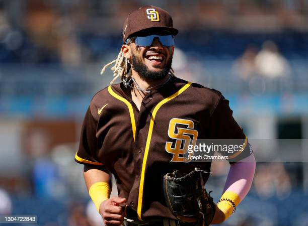 Fernando Tatis Jr. #23 of the San Diego Padres reacts after a double play in the second inning against the Seattle Mariners during the MLB spring...