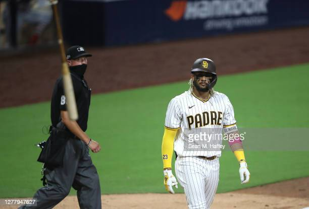 Fernando Tatis Jr. #23 of the San Diego Padres reacts after his two-run homerun during the seventh inning of Game Two of the National League Wild...
