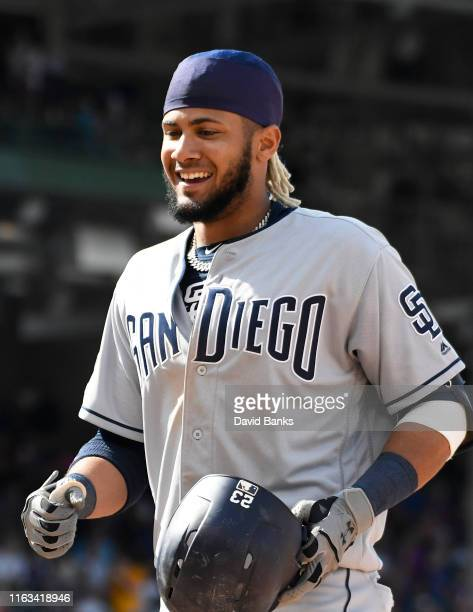Fernando Tatis Jr #23 of the San Diego Padres reacts after hitting a tworun single against the Chicago Cubs during the ninth inning at Wrigley Field...