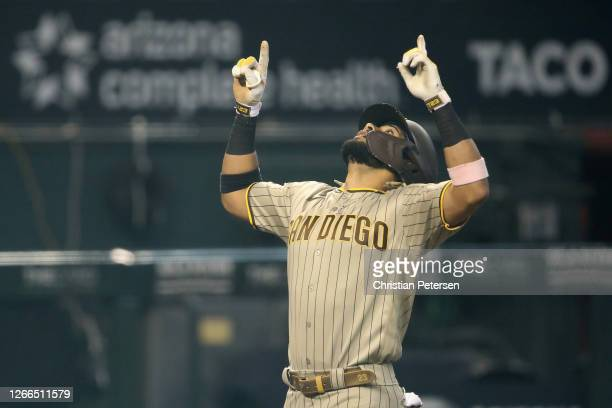 Fernando Tatis Jr. #23 of the San Diego Padres reacts after hitting a solo home run against the Arizona Diamondbacks during the first inning of the...