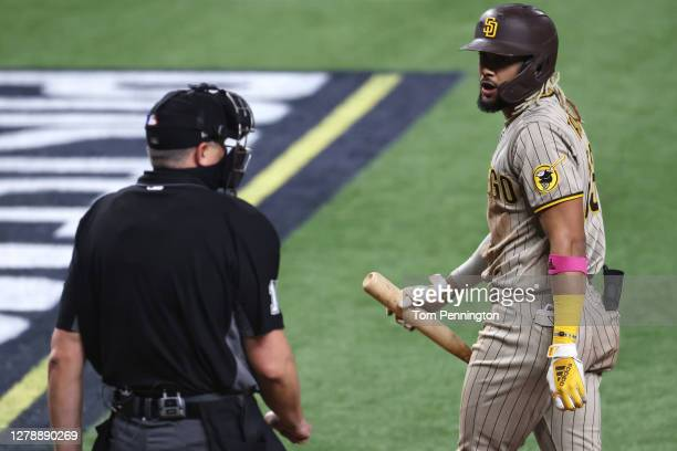 Fernando Tatis Jr. #23 of the San Diego Padres reacts after striking out during the third inning of Game One of the National League Divisional Series...