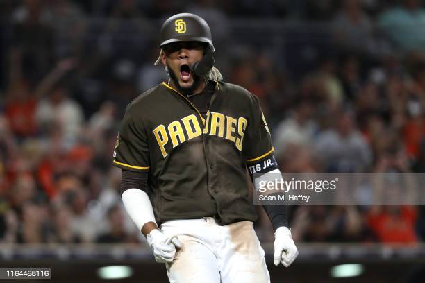 Fernando Tatis Jr #23 of the San Diego Padres reacts to flying out during the eighth inning of a game against the San Francisco Giants at PETCO Park...