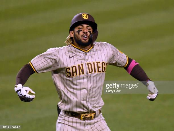 Fernando Tatis Jr. #23 of the San Diego Padres reacts to his solo homerun, his second of the game, to take a 3-2 lead over the Los Angeles Dodgers...