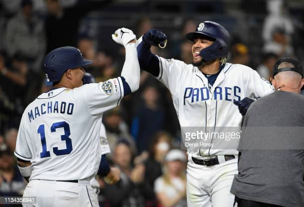 Fernando Tatis Jr #23 of the San Diego Padres right is congratulated by Manny Machado after hitting a tworun home run during the sixth inning of a...