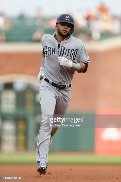 Fernando Tatis Jr #23 of the San Diego Padres rounds the bases after hitting a leadoff home run in the top of the first inning against the San...