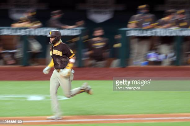 Fernando Tatis Jr. #23 of the San Diego Padres rounds the bases after hitting a three-run home run against the Texas Rangers in the top of the...