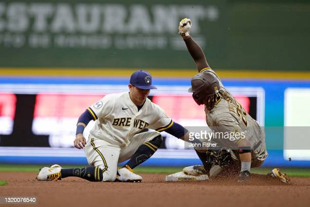 Fernando Tatis Jr. #23 of the San Diego Padres steals second base past the tag of Luis Urias of the Milwaukee Brewers in the eighth inning against...